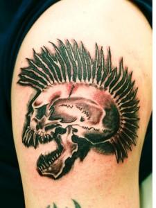 Exploited Skull Tattoo