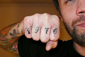 1976 finger tattoo
